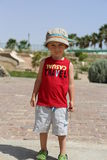 Little boy standing in the red shirt. And hat Stock Image