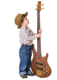 Little boy standing with rock guitar Royalty Free Stock Images