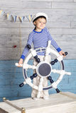 Little boy standing with steering wheel Royalty Free Stock Image