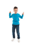 Little boy standing in studio Royalty Free Stock Images