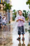 Little boy standing under the rain Royalty Free Stock Photos