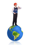 Little boy stands on the big earth. Royalty Free Stock Images