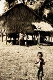 A Little boy stands before bothy Stock Images