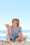 Little boy with a starfish Royalty Free Stock Photo
