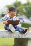 Little boy staring at a tablet Stock Images