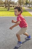 The little boy starts to run. stock photography