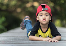 A little boy stay alone with marvel caps. Portraits children stay alone into the wild stock photo
