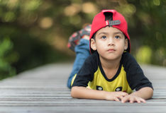 A little boy stay alone with marvel caps. Portraits children stay alone into the wild royalty free stock photo