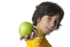 Little boy sticking out an apple Stock Photography