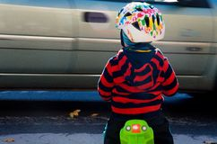 Little boy stop because of speeding car Royalty Free Stock Images