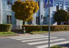 Little boy stopped in fron of zebra crossing Stock Image