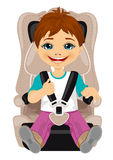 Little boy strapped to a car seat. On white background Stock Images