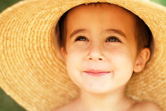 Little boy in straw hat Stock Photography