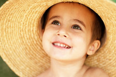 Little boy in straw hat Stock Images