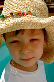 Little Boy in a Straw Hat. Little boy in a big women's straw hat Stock Photo