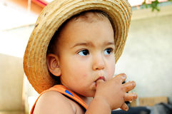 Little boy with straw hat Royalty Free Stock Images