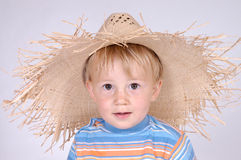 Little boy with straw hat II royalty free stock photography