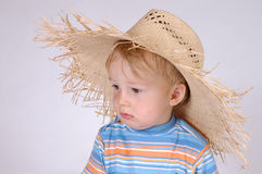 Little boy with straw hat IV. Portrait of a little boy Royalty Free Stock Image