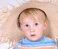 Little boy with straw hat V. Portrait of a little boy Royalty Free Stock Image