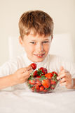 Little boy with strawberry Stock Photo