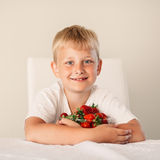 Little boy with strawberry Royalty Free Stock Image