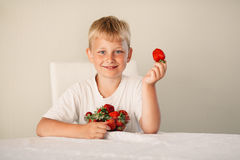 Little boy with strawberry Royalty Free Stock Photography