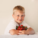 Little boy with strawberry Royalty Free Stock Photos