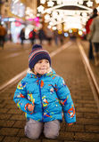 Little boy on a street with Christmas decoration and lights Stock Images
