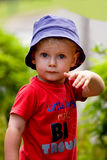 Little boy striking a pose Stock Image
