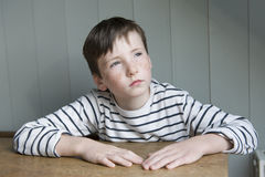 Little boy in striped shirt. Portrait of little boy in striped sailor shirt dreaming Royalty Free Stock Images