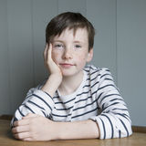 Little boy in striped shirt Stock Images