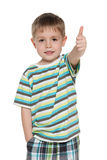 Little boy in striped shirt holds his thumb up Stock Photography