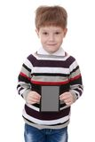 Little boy in striped shirt holds up a rectangular Royalty Free Stock Image