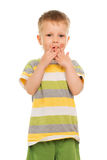 Little boy in striped t-shirt. Playing with his fingers. Isolated on white stock images