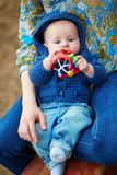 Little boy in stroller playing with toys Stock Photos
