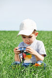 The little boy studies to photograph Royalty Free Stock Photo