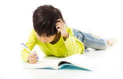 Little boy study on the floor. Confuse Little boy study on the floor Royalty Free Stock Images