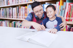 Little boy studying with his teacher Stock Images