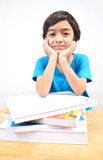 Little boy studying text books Stock Photo