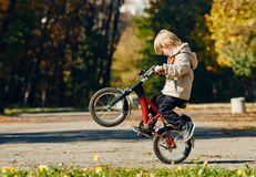Little boy stuntman. Boy Biker jumping outdoor autumn park. Sofia Bulgaria Royalty Free Stock Photography