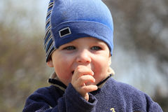 Little boy sucking his thumb Royalty Free Stock Photography