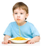 Little boy is eating spaghetti Royalty Free Stock Photos