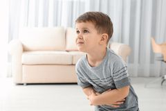 Little boy suffering from nausea royalty free stock photos