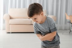 Little boy suffering from nausea in room royalty free stock images