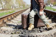Little boy with suit case on railway Royalty Free Stock Images
