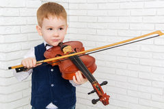 Little boy in a suit playing the violin Stock Images