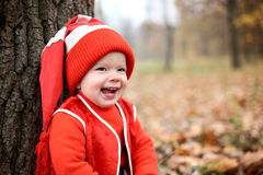 Little boy in a suit with a pumpkin gnome in autumn park Royalty Free Stock Image