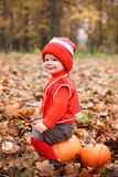 Little boy in a suit with a pumpkin gnome in autumn park Stock Photography
