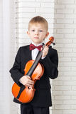 Little boy in a suit standing with violin Stock Photography