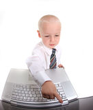 Little Boy in a Suit Working on a Laptop Computer Stock Photography